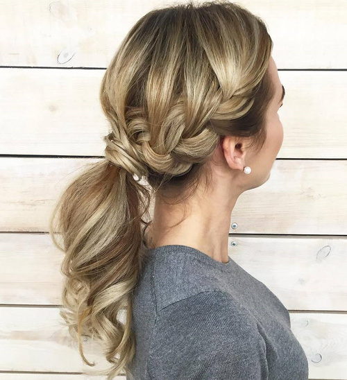 Messy Low Ponytail With A Side Braid