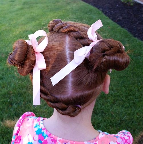 girls' double buns with twists hairstyle