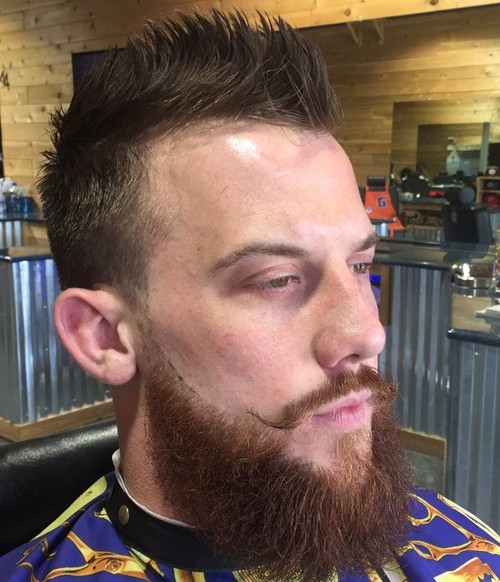 red fauxhawk hairstyle with full red beard