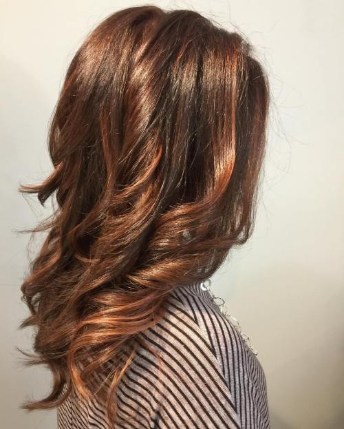 medium length wavy auburn balayage hair