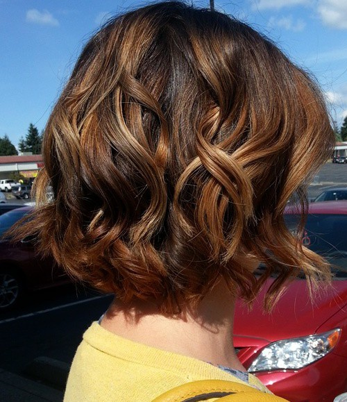 wavy dark brown bob with caramel highlights