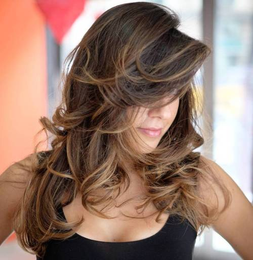 Layered Curly Brunette Hair With Highlights