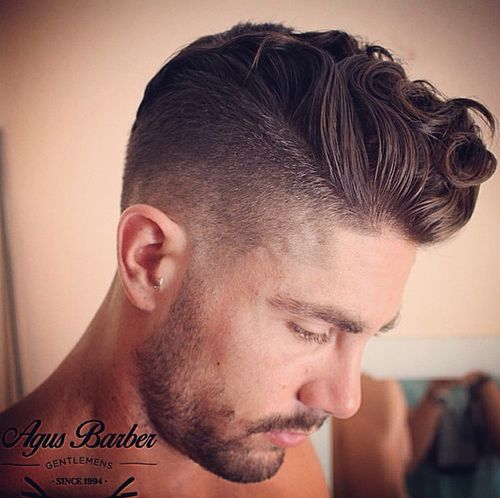 curly pompadour hairstyle for men