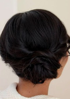 messy side low bun for shorter hair