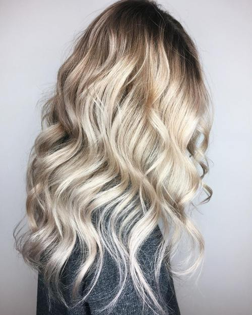 Platinum Blonde Balayage With Root Fade