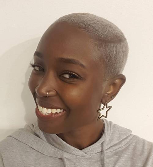short blonde afro with undercuts