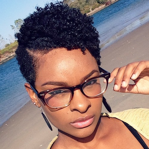 women's short black hairstyle with curly top