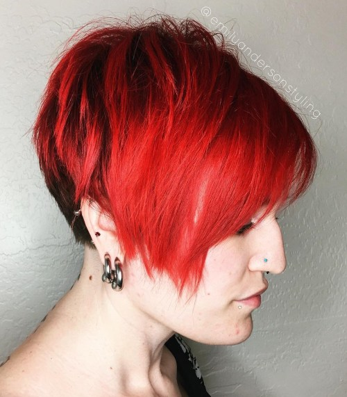 bright red asymmetrical pixie with side bangs