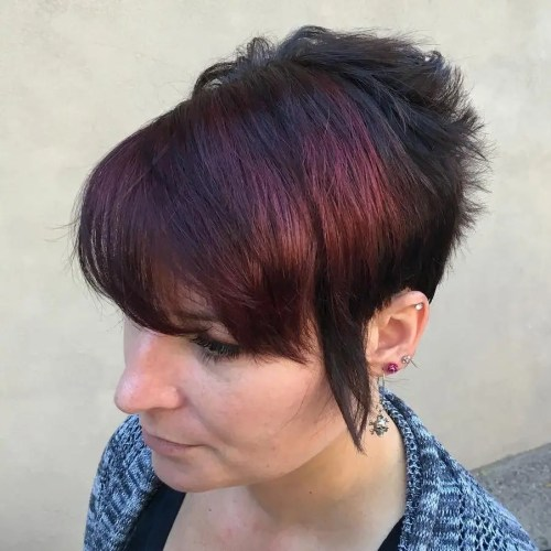 short black hairstyle with burgundy peekaboo highlights