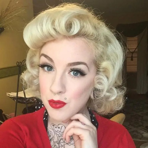 medium-length blonde pin up hairstyle