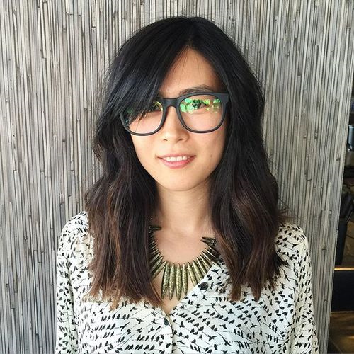 low maintenance brunette hairstyle with bangs
