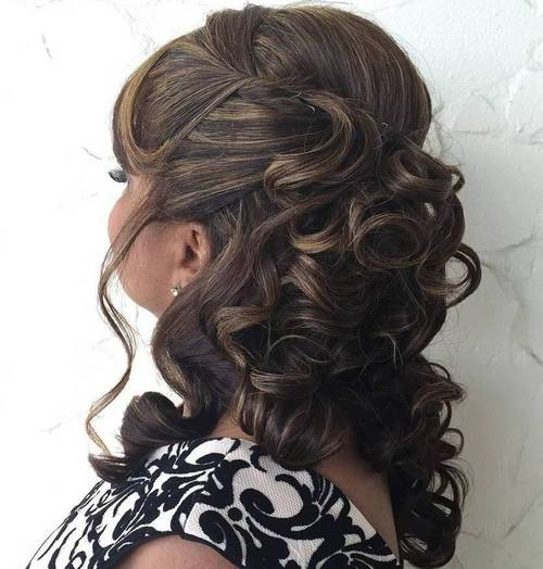 formal curly half up hairstyle for mature women