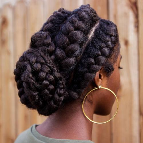 black bun updo with goddess braids