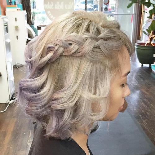 silver blonde curly bob with a braid