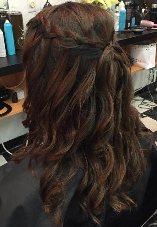 curly braided half updo for layered hair