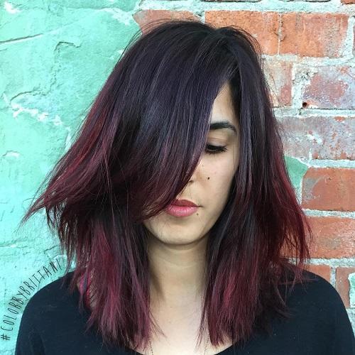 medium shaggy black haircut with mahogany ends