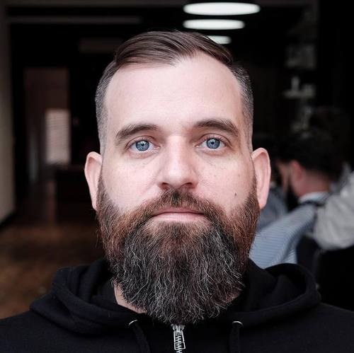 short hairstyle and full beard