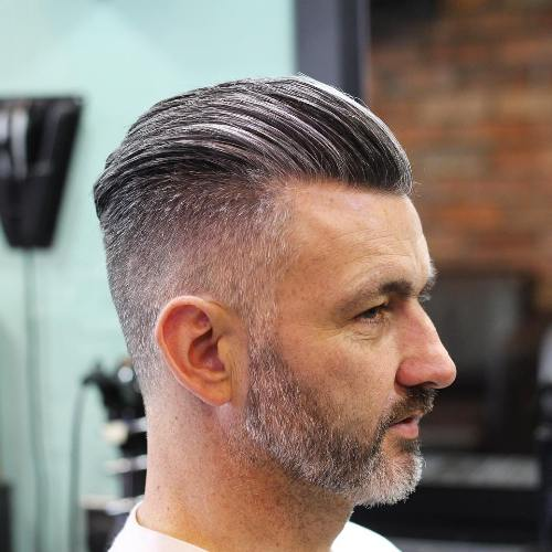 #1: Salt And Pepper Slick Back. Long Top Short Side Gray Hairstyle