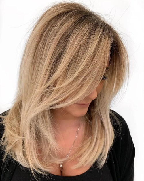 Mid-Length Feathered Caramel Blonde Hairstyle