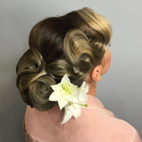 Wavy Chignon Updo With A Flower