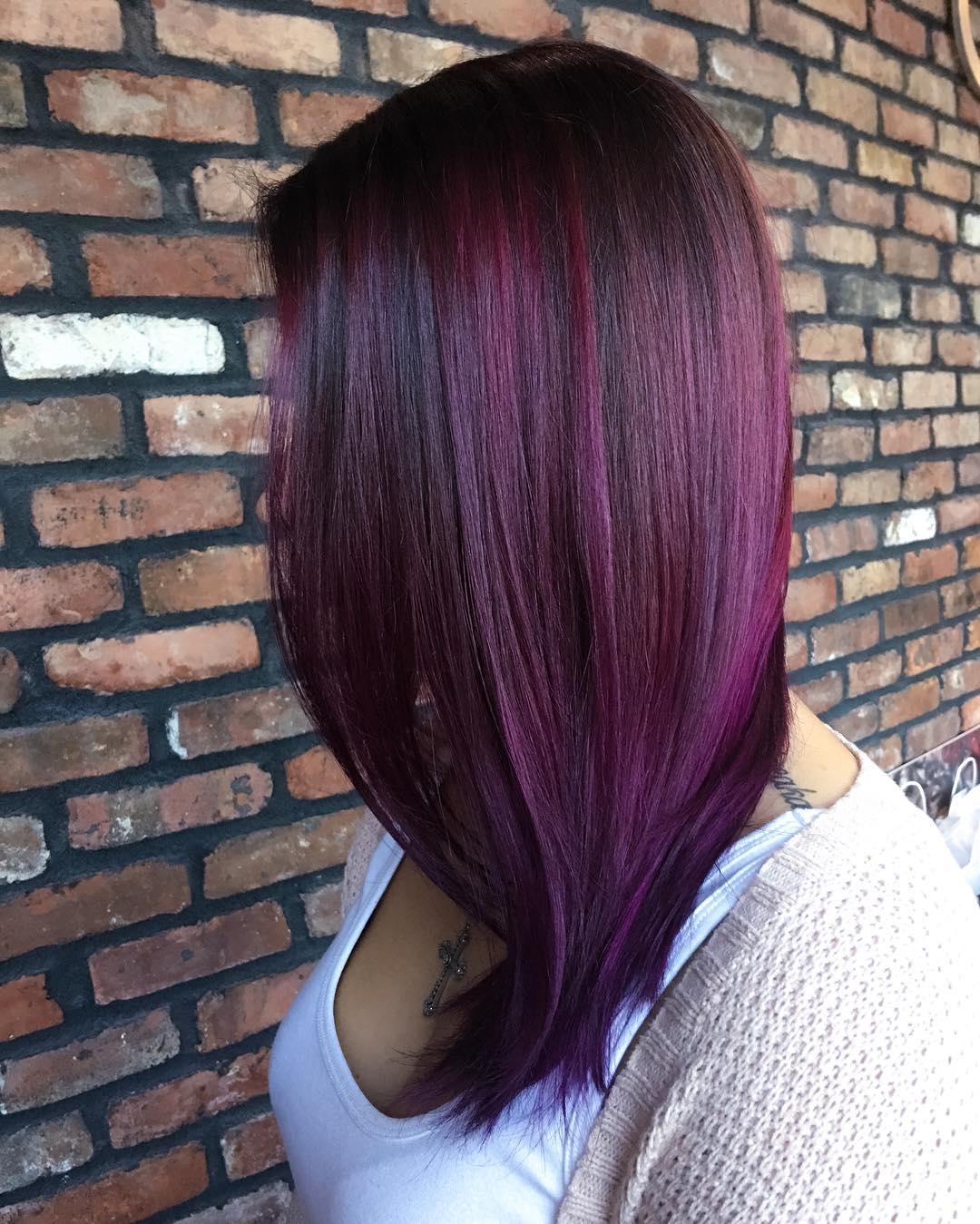 Dark brown hair with plum highlights