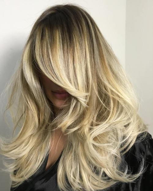 Long Blonde Layered Hairstyle With Roots Fade