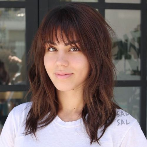 Mid-Length Layered Cut With Wispy Bangs