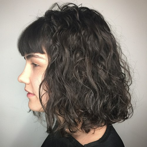 Long Perm Hairstyle With Thin Curls And Short Bangs