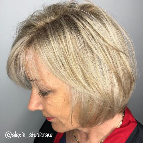 Layered Wheat Blonde Bob With Bangs