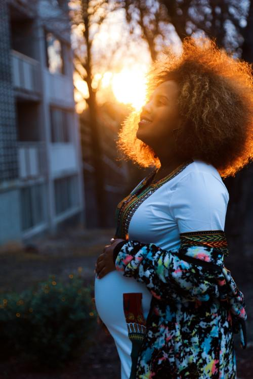 A Woman With Natural Hair With Her Hair Dyed When Pregnant