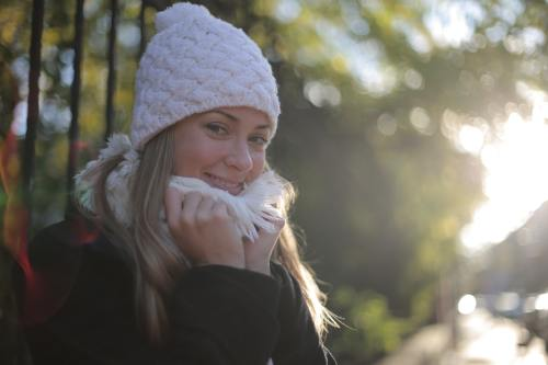 Woman Wearing a Hat to Protect Hair in Winter