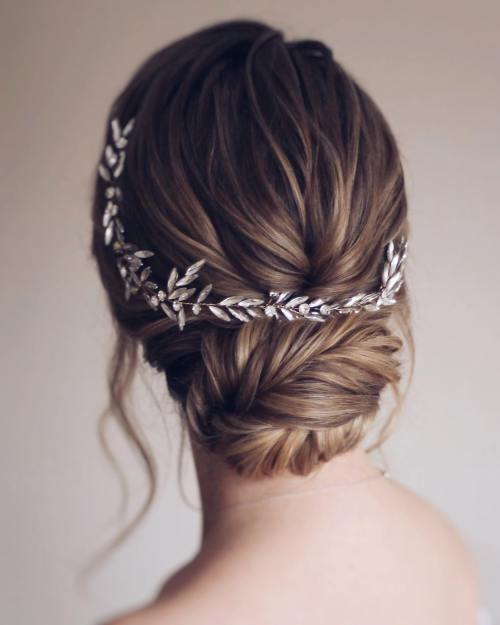 Bridal Hair Low Textured Bun with a Crystal Vine