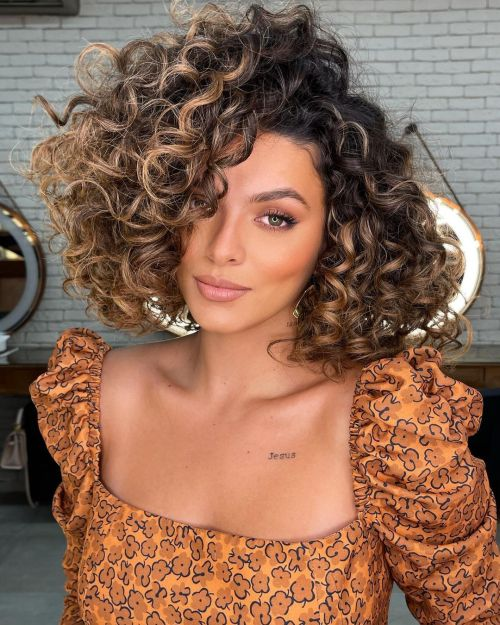 Voluminous Curly Hairstyles with Caramel Highlights