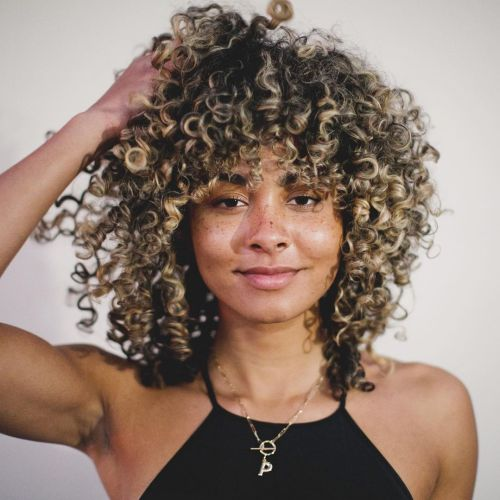 Shoulder Length Curly Hairstyle with Bangs and Highlights