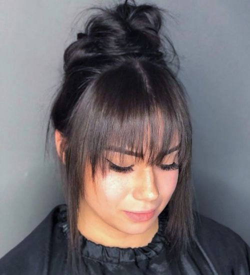 Messy Bun with Bangs and Face Framing Pieces