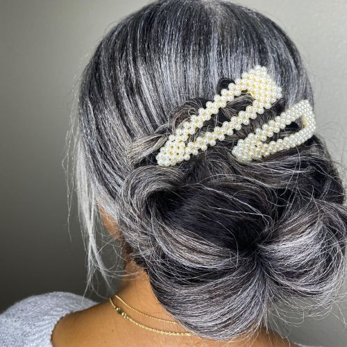 Pearl Clips Against Salt and Pepper Hair