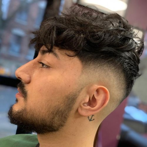 High Fade and Longer Wavy Hair on Top