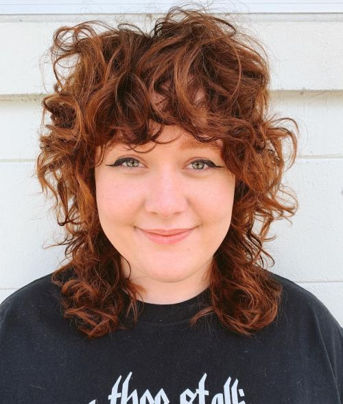 Curly Shaggy Hair Style for a Round Face