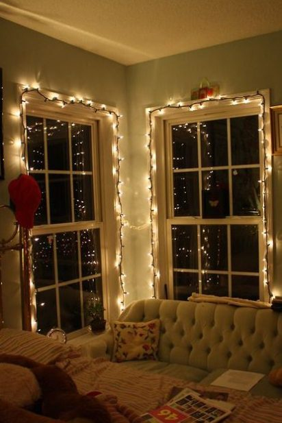 Lights, christmas lights around a window pane and comfortable fairy light lit seating area with a cozy vibe