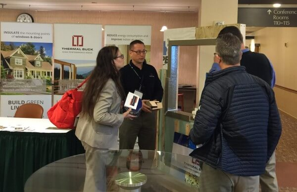 PHRC conference March 2016 John at booth explaining ThermalBuck benefits and features to attendees and presenters