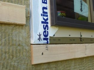 """2.5"""" ThermalBuck with 2.0"""" Rockwool ComfortBoard & 3/4"""" Horizontal Strapping integrated with Henry Blueskin Self-Adhered WRB."""