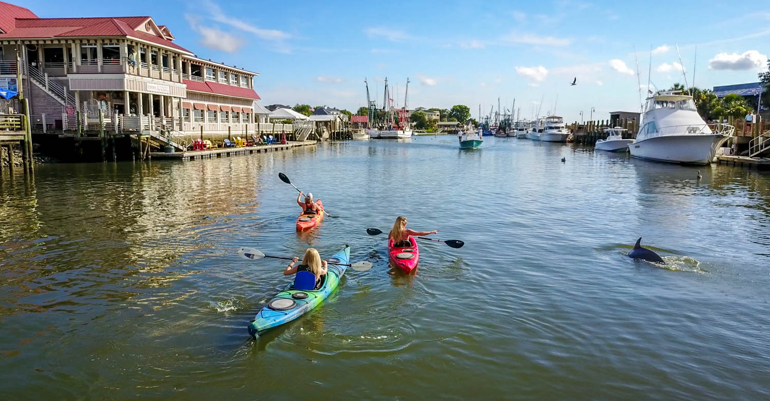 A group of friends kayaking in Charleston, South Carolina