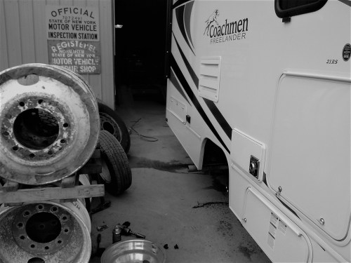 RV with tire removed