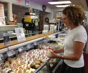 Lynne Devereux at the cheese case