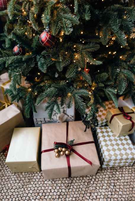 christmas gift boxes under fir tree