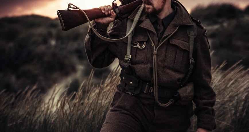 photo of a man holding a gun