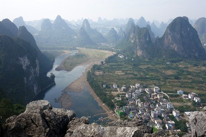 backpacking in China, A guide to the Guilin area of China: Yangshuo, Xingping and beyond, Things to do in Guilin, what to do, guide, where to stay in Guilin, how to get to Yangshuo, bus, train, minibus, transport, time, farms, rural, climbing, hike, bamboo raft, scams, karst, mountains, river, Li, Yulong, cycling, bike, hire a bike, this old place, sadder street, guilin china, guilin tour, guilin weather, guilin travel,yangshuo china, yangshuo hotels, guilin yangshuo, yangshuo hostel, yangshou rock climbing, Yangshuo mountains, li river cruise, Xingping china, Xingping this old place international hostel, singling hostel, backpacking china,