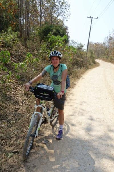 Riding up to the amazing Kuang Si Waterfall before hiking through the jungle to a tribal village with Grasshopper Bike tours, Laos, waterfall, swim, how to get to the Kuang Si Waterfall, Luang Prabang, village, trekking, hiking, things to do outside Luang Prabang, tribe, bamboo house, bike, explore, attractions, price, where to go, things to see,