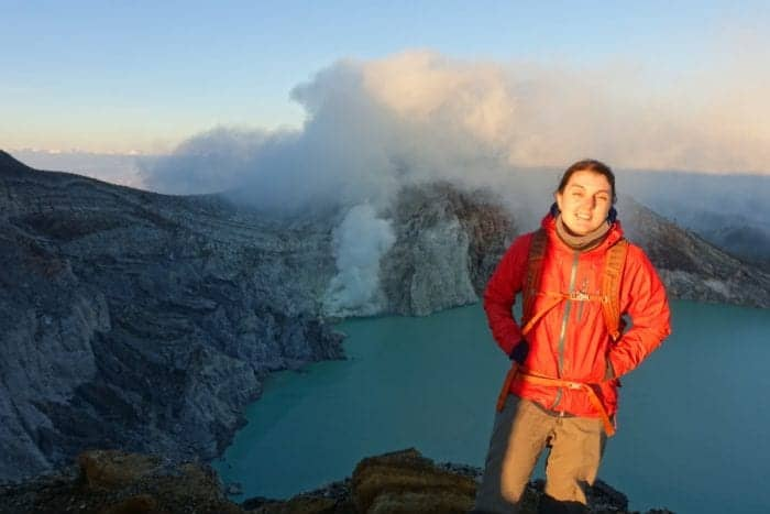 Climbing the smouldering live volcano Kawah Ijen in protective masks for sunrise over the sulphuric acid lake and blue flame crater, Indonesia!