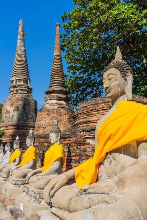 yellow sashes on buddha statues, Ayutthaya day trip from Bangkok, Ayutthaya tour from Bangkok, Getting to Ayutthaya from Bangkok, Ayutthaya day tour from Bangkok, bus Bangkok to Ayutthaya, train Bangkok to Ayutthaya, how to get to Ayutthaya from Bangkok by train, day trip to Ayutthaya from Bangkok, Bangkok to Ayutthaya train, best day trip from Bangkok, Ayutthaya Day Trip From Bangkok, Thailand